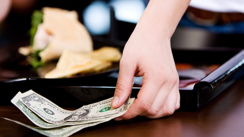 20151203195418-coffee-shop-server-picking-up-cash-tip-tipping-gratuity-money-customer